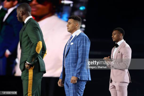 Kyle Pitts, Rashawn Slater and Patrick Surtain II stand onstage prior to the start of round one of the 2021 NFL Draft at the Great Lakes Science...