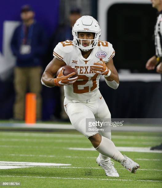 Kyle Porter of the Texas Longhorns runs with the ball after catching a screen pass in the third quarter against the Missouri Tigers at NRG Stadium on...