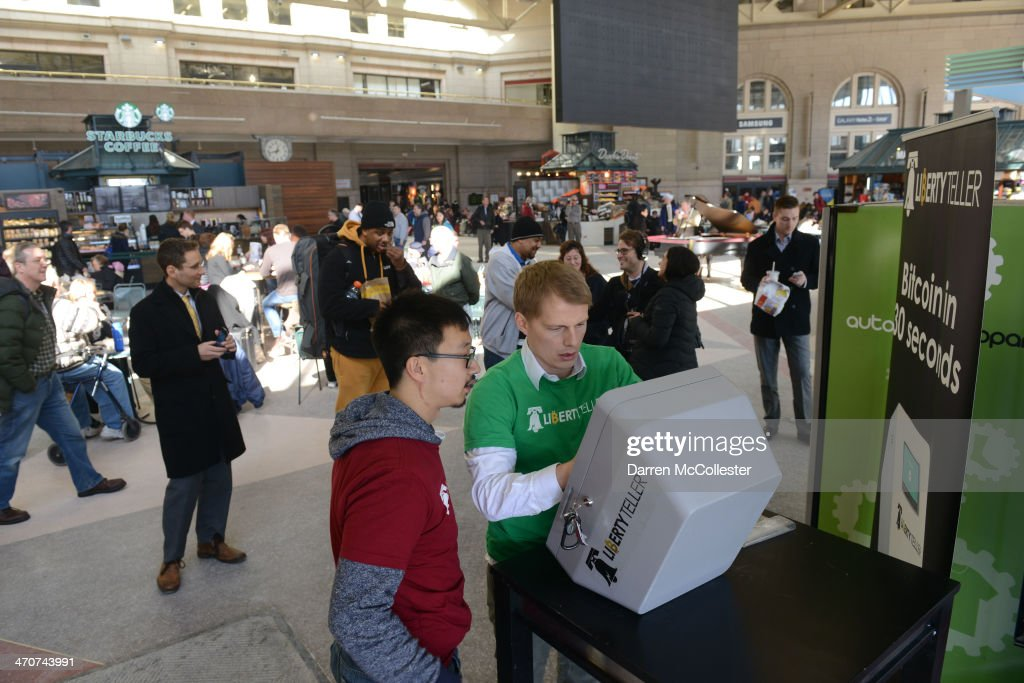 Kyle Powers (L) and Chris Yim of Liberty Teller install a Bitcoin ATM at South Station February 20, 2014 in Boston, Massachusetts. The ATM was placed by Liberty Teller to help inform people about the digital currency, which can be bought and sold anonymously, and can be used at a number of online retailers in place of cash or credit cards..