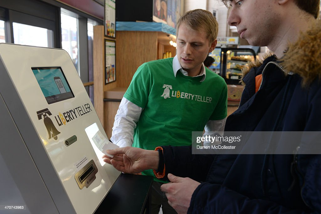 Kyle Powers of Liberty Teller helps Jordan Persson (R) purchase Bitcoin from a newly installed Bitcoin ATM at South Station February 20, 2014 in Boston, Massachusetts. The ATM was placed by Liberty Teller to help inform people about the digital currency, which can be bought and sold anonymously, and can be used at a number of online retailers in place of cash or credit cards.