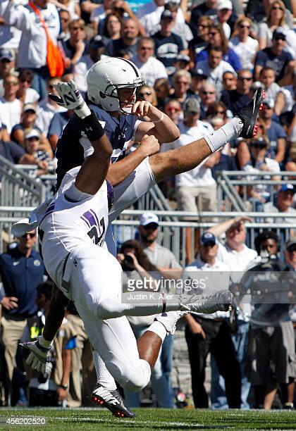 Kyle Queiro of the Northwestern Wildcats attempts to block a punt by Chris Gulla of the Penn State Nittany Lions in the first half during the game on...