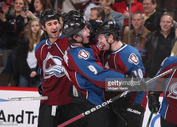Kyle Quincey and Matt Duchene of the Colorado Avalanche congratulate Kyle Cumiskey after the game winning goal against the Atlanta Thrashers at the...