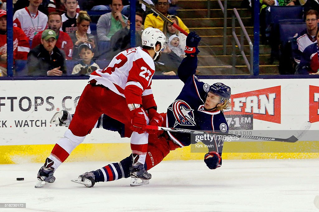 Kyle Quincey #27 of the Detroit Red Wings knocks down William Karlsson #25 of the Columbus Blue Jackets during the second period on March 17, 2016 at Nationwide Arena in Columbus, Ohio.
