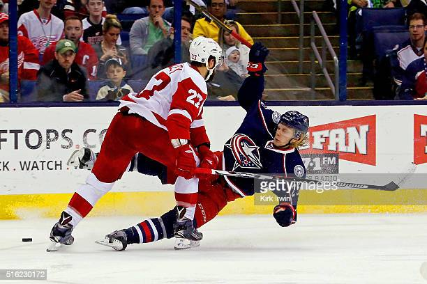 Kyle Quincey of the Detroit Red Wings knocks down William Karlsson of the Columbus Blue Jackets during the second period on March 17 2016 at...