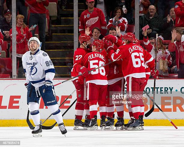 Kyle Quincey Teemu Pulkkinen Danny DeKeyser and Stephen Weiss of the Detroit Red Wings congratulate teammate Joakim Andersson after scoring a goal...