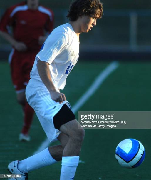 Kyle Reddy Broomfield High School dribbles the ball keeping it from Glenwood Springs High School players during the first state playoff game at...