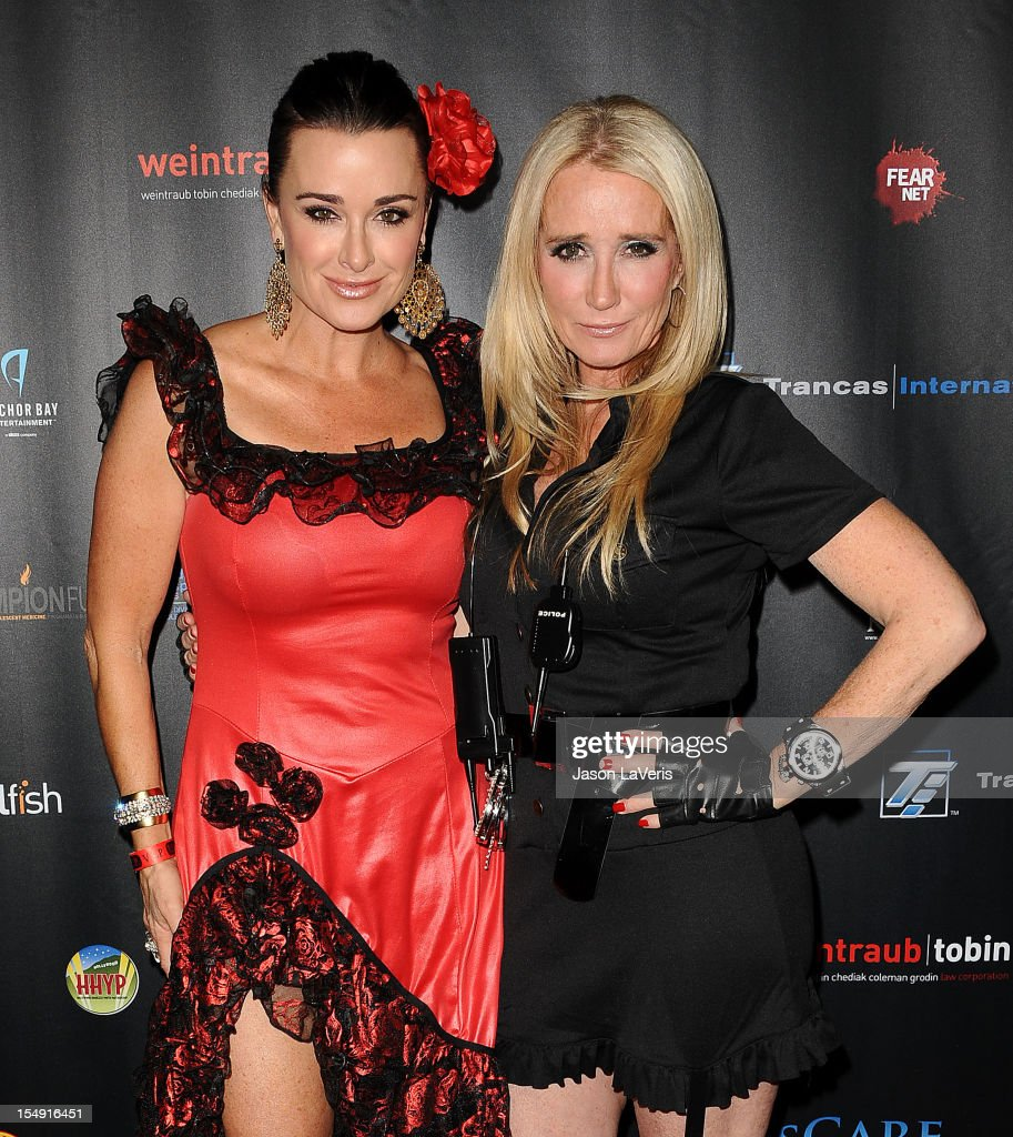 Kyle Richards and Kim Richards attend the sCare Foundation's 2nd annual Halloween benefit event at The Conga Room at L.A. Live on October 28, 2012 in Los Angeles, California.