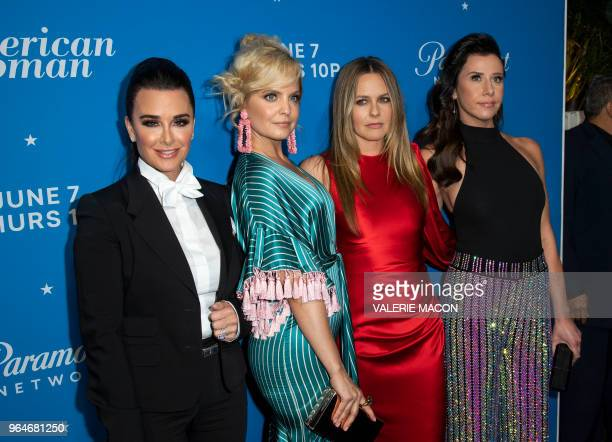 Kyle Richards Mena Suvari Alicia Silverstone and Jennifer Bartels attend American Woman Premiere Party at Chateau Marmont on May 31 in Los Angeles...