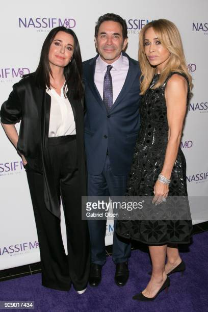 Kyle Richards Paul S Nassif and Faye Resnick arrive for Dr Paul Nassif's unveiling of his new medical spa with grand opening and ribboncutting...