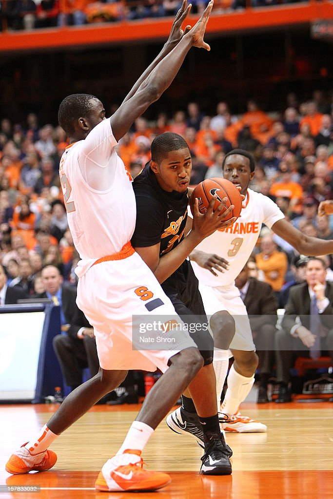 Kyle Richardson #34 of the Long Beach State 49ers drives to the basket against Baye Moussa Keita #12 and Jerami Grant #3 of the Syracuse Orange during the game at the Carrier Dome on December 6, 2012 in Syracuse, New York.