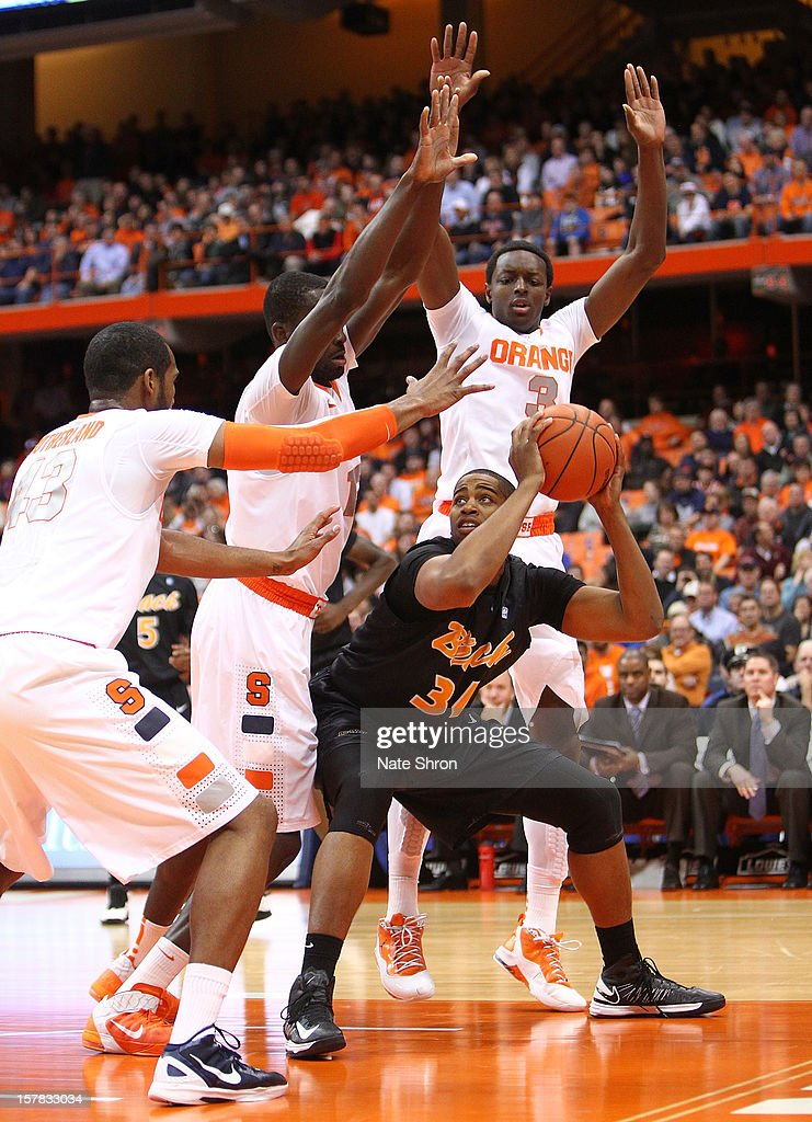 Kyle Richardson #34 of the Long Beach State 49ers drives to the basket against Baye Moussa Keita #12, James Southerland #43 and Jerami Grant #3 of the Syracuse Orange during the game at the Carrier Dome on December 6, 2012 in Syracuse, New York.
