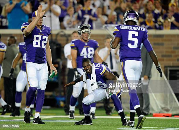 Kyle Rudolph and Greg Jennings of the Minnesota Vikings congratulate teammate Teddy Bridgewater after a twopoint conversion against the Arizona...