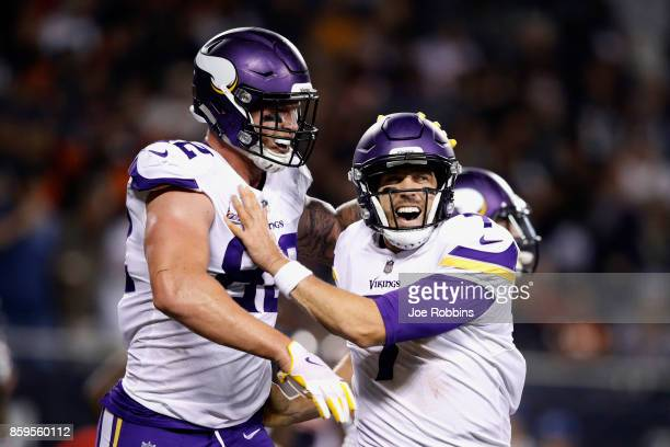 Kyle Rudolph and quarterback Case Keenum of the Minnesota Vikings celebrate after Rudolph scored against the Chicago Bears in the third quarter at...