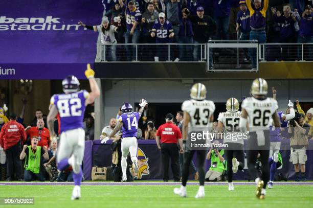 Kyle Rudolph and Stefon Diggs of the Minnesota Vikings celebrate a touchdown by Diggs as Marcus Williams Craig Robertson and PJ Williams of the New...