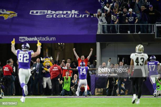 Kyle Rudolph and Stefon Diggs of the Minnesota Vikings celebrate a touchdown by Diggs as Marcus Williams of the New Orleans Saints looks on during...