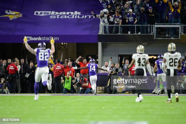 Kyle Rudolph and Stefon Diggs of the Minnesota Vikings celebrate a touchdown by Diggs as Marcus Williams and PJ Williams of the New Orleans Saints...