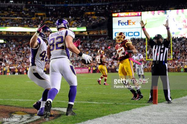 Kyle Rudolph celebrates with Rhett Ellison of the Minnesota Vikings after scoring a 1-yard touchdown on a pass from Christian Ponder in the second...
