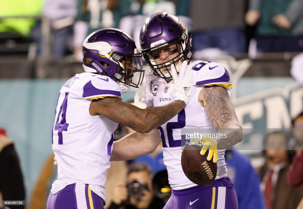Kyle Rudolph #82 is congratulated by his teammate Stefon Diggs #14 of the Minnesota Vikings after scoring a first quarter touchdown against the Philadelphia Eagles in the NFC Championship game at Lincoln Financial Field on January 21, 2018 in Philadelphia, Pennsylvania.