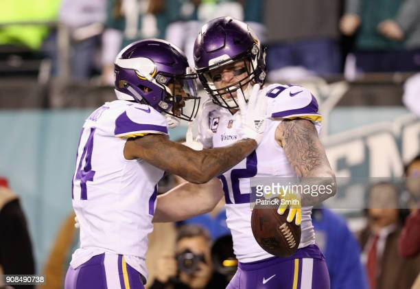 Kyle Rudolph is congratulated by his teammate Stefon Diggs of the Minnesota Vikings after scoring a first quarter touchdown against the Philadelphia...