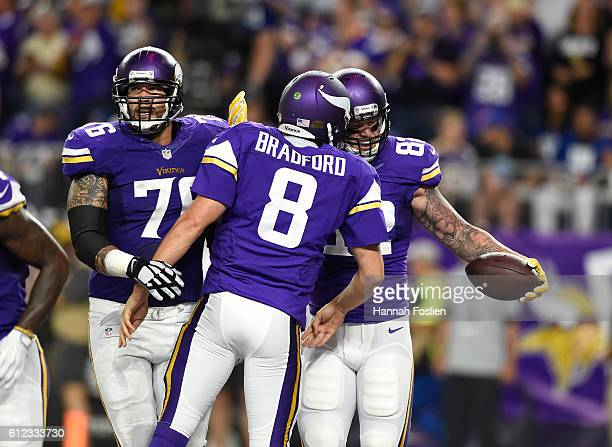 Kyle Rudolph of the Minnesota Vikings and quarterback Sam Bradford celebrate a touchdown in the second quarter of the game against the New York...
