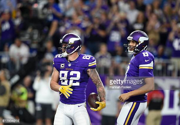 Kyle Rudolph of the Minnesota Vikings and quarterback Sam Bradford celebrate after connecting for a touchdown in the second quarter of the game...