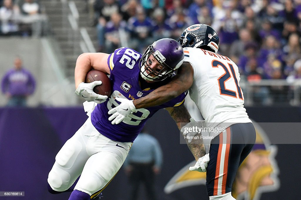 Kyle Rudolph #82 of the Minnesota Vikings breaks a tackle after catching the ball for a 22 yard touchdown in the second quarter of the game against the Chicago Bears on January 1, 2017 at US Bank Stadium in Minneapolis, Minnesota.