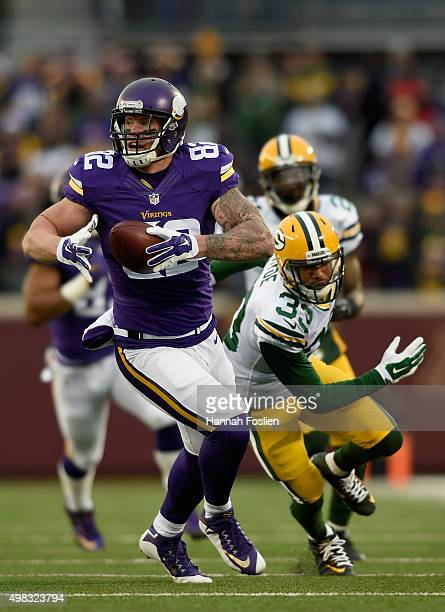 Kyle Rudolph of the Minnesota Vikings carries the ball against Micah Hyde of the Green Bay Packers during the first quarter of the game on November...