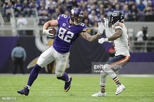 Kyle Rudolph of the Minnesota Vikings carries the ball against Tracy Porter of the Chicago Bears during the game on January 1 2017 at US Bank Stadium...