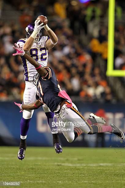 Kyle Rudolph of the Minnesota Vikings catches a pass against Major Wright of the Chicago Bears at Soldier Field on October 16 2011 in Chicago Illinois
