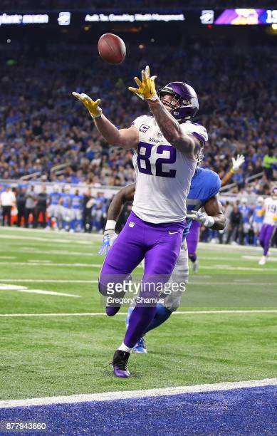 Kyle Rudolph of the Minnesota Vikings catches a pass over his shoulder against the Detroit Lions for a touchdown during the second quarter at Ford...
