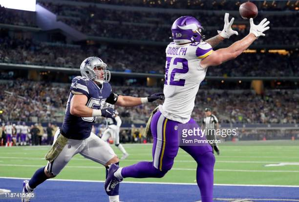 Kyle Rudolph of the Minnesota Vikings catches his second touchdown pass of the first quarter against Sean Lee of the Dallas Cowboys at AT&T Stadium...