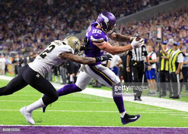 Kyle Rudolph of the Minnesota Vikings catches the ball for a 15 yard touchdown in the fourth quarter of the game against the New Orleans Saints on...