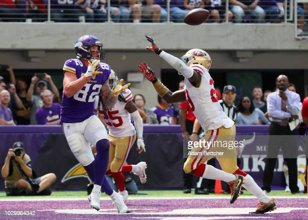 Kyle Rudolph of the Minnesota Vikings catches the ball in the end zone for a touchdown over defender Jaquiski Tartt of the San Francisco 49ers in the...