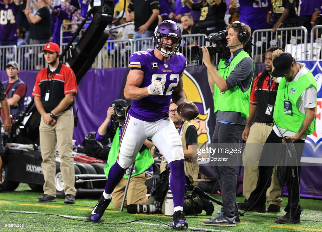 Kyle Rudolph #82 of the Minnesota Vikings celebrates a 15 yard touchdown in the fourth quarter of the game against the New Orleans Saints on September 11, 2017 at U.S. Bank Stadium in Minneapolis, Minnesota.