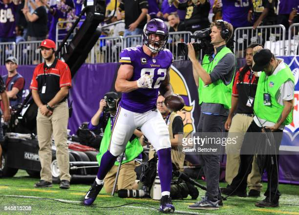 Kyle Rudolph of the Minnesota Vikings celebrates a 15 yard touchdown in the fourth quarter of the game against the New Orleans Saints on September 11...