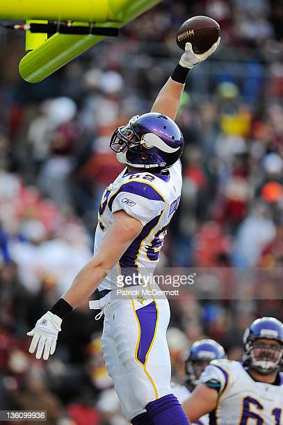 Kyle Rudolph of the Minnesota Vikings celebrates after catching a touchdown pass from Joe Webb of the Minnesota Vikings during a game against the...