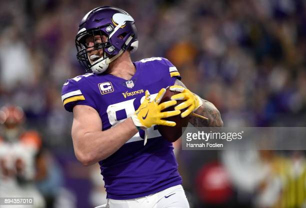 Kyle Rudolph of the Minnesota Vikings celebrates after catching the ball for a touchdown in the third quarter of the game against the Cincinnati...