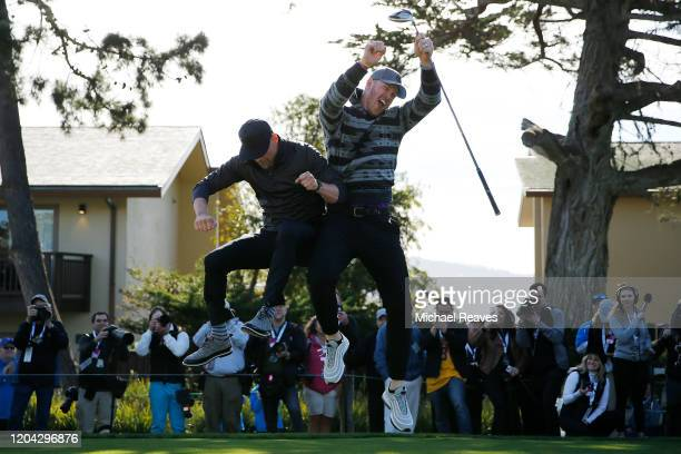 Kyle Rudolph of the Minnesota Vikings celebrates with actor Josh Duhamel prior to the 3M Celebrity Challenge prior to the ATT Pebble Beach ProAm at...