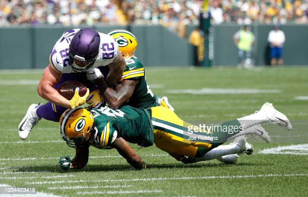 Kyle Rudolph of the Minnesota Vikings gets tackled during the first quarter of a game against the Green Bay Packers at Lambeau Field on September 16...