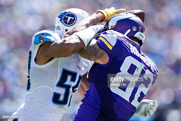 Kyle Rudolph of the Minnesota Vikings has a pass knocked away by Sean Spence of the Tennessee Titans at Nissan Stadium on September 11 2016 in...