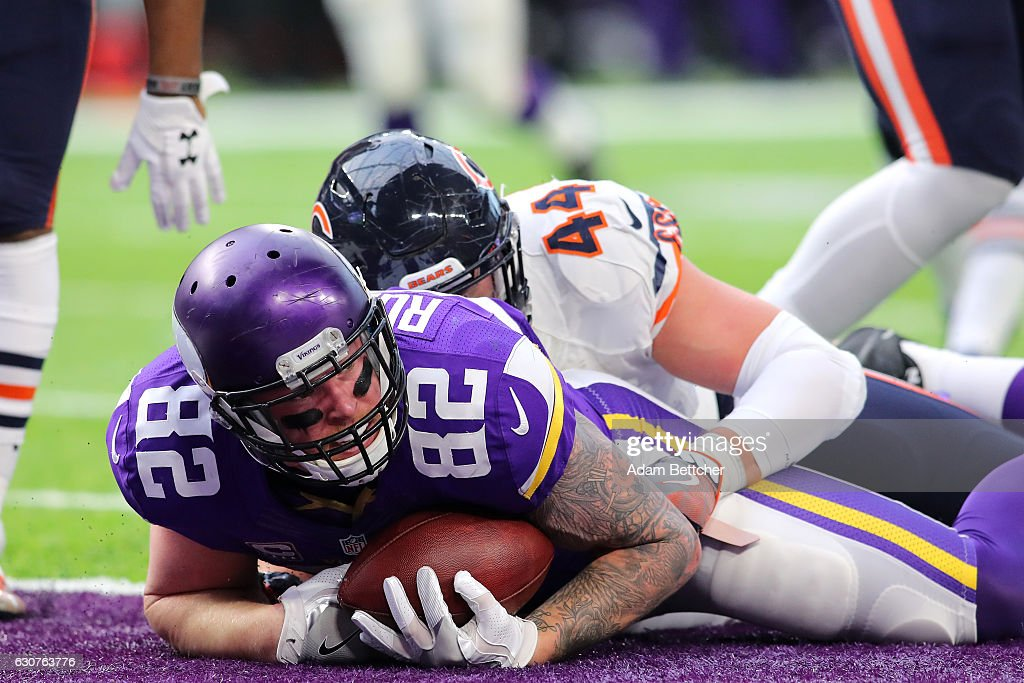 Kyle Rudolph #82 of the Minnesota Vikings in the end zone with the ball on a 22 yard touchdown play in the second quarter of the game agains the Chicago Bears on January 1, 2017 at US Bank Stadium in Minneapolis, Minnesota.