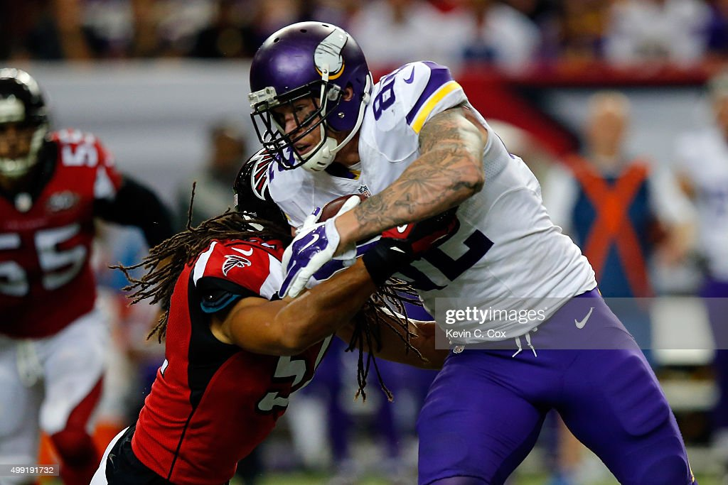 Kyle Rudolph #82 of the Minnesota Vikings is tackled by Philip Wheeler #51 of the Atlanta Falcons after a catch during the second half at the Georgia Dome on November 29, 2015 in Atlanta, Georgia.
