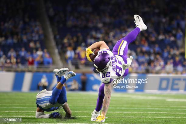 Kyle Rudolph of the Minnesota Vikings is tackled by Quandre Diggs of the Detroit Lions in the second half at Ford Field on December 23 2018 in...