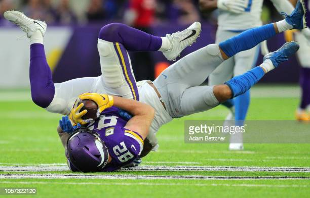 Kyle Rudolph of the Minnesota Vikings is tackled with the ball in the fourth quarter of the game against the Detroit Lions at US Bank Stadium on...