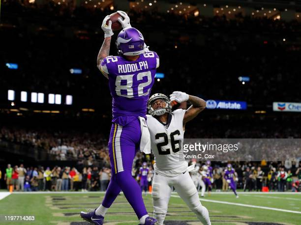 Kyle Rudolph of the Minnesota Vikings makes the game-winning touchdown reception against P.J. Williams of the New Orleans Saints during overtime in...