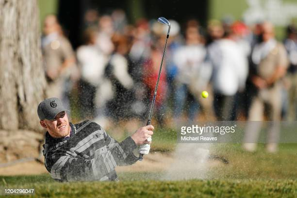 Kyle Rudolph of the Minnesota Vikings plays a shot from a bunker on the 18th hole during the 3M Celebrity Challenge prior to the ATT Pebble Beach...