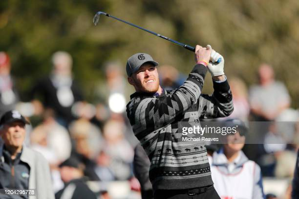Kyle Rudolph of the Minnesota Vikings plays his shot from the 17th tee during the 3M Celebrity Challenge prior to the ATT Pebble Beach ProAm at...