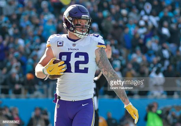 Kyle Rudolph of the Minnesota Vikings reacts after a touchdown against the Carolina Panthers in the first quarter during their game at Bank of...