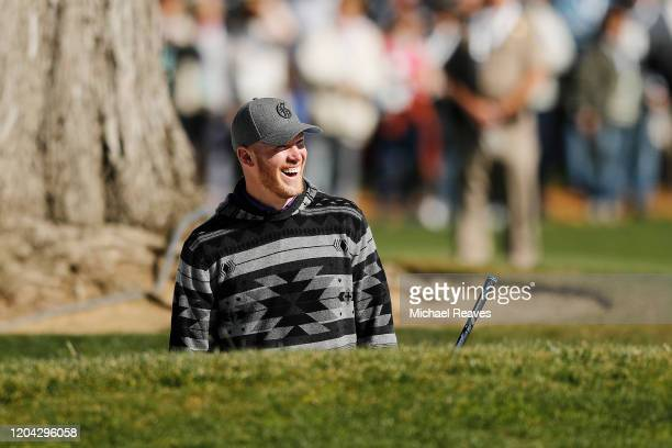 Kyle Rudolph of the Minnesota Vikings reacts after playing a shot from a bunker on the 18th hole during the 3M Celebrity Challenge prior to the ATT...