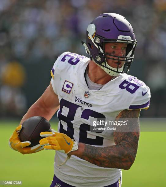 Kyle Rudolph of the Minnesota Vikings runs after a catch against the Green Bay Packers at Lambeau Field on September 16 2018 in Green Bay Wisconsin...
